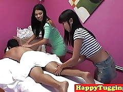 Asian masseuses tugging coupled..